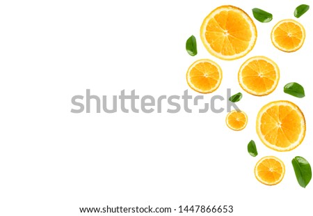 The oranges are pieces that are placed on a white background with patterns as background. #1447866653