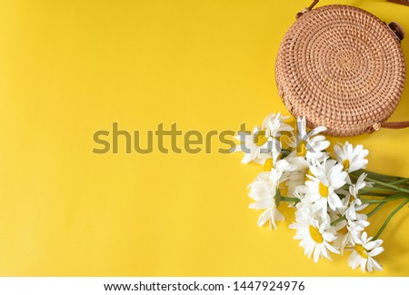 Summer background, vacation concept, round rattan bag and flowers, minimal composition, top view, copy space. #1447924976