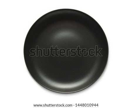 Top view empty ceramic round black  plate isolated on white with clipping path and shadow. #1448010944