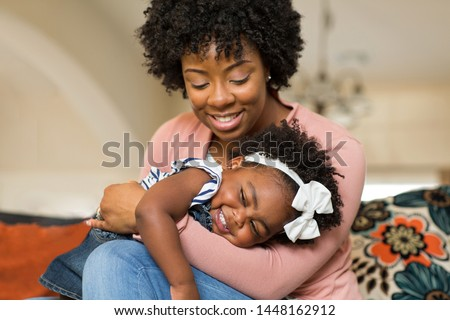 African American mother playing together.