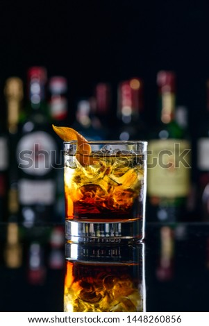 Negroni Cocktail with Orange Twist and Pin, on Dark Background. Beverage Photography. classic cocktail negroni blur bar #1448260856