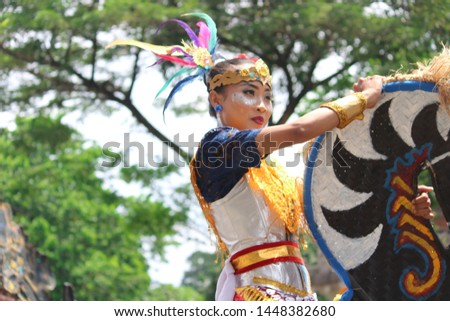 Jakarta, Indonesia - Juni 23, 2019 : The dance performance using a horse board is called Kuda Lumping in Jakarta, Indonesia. #1448382680