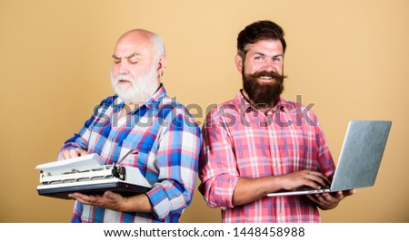 Master new technologies. Modern life and remnants of past. Senior man with typewriter and hipster with laptop. Battle of technologies. Men work writing devices. Old generation. Digital technologies. #1448458988
