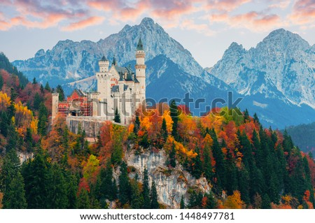 Picturesque autumn view on Neuschwanstein Castle with colorful trees and the Alps on background, Bavaria, Germany. Beautiful autumn colorful scenery. #1448497781