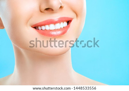 Perfect healthy smile of a young woman. Teeth Whitening. Dental Care Concept. Promotional picture for a dental clinic. #1448533556