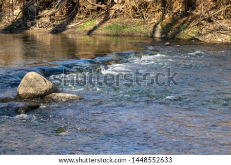 Cool clear water running down a small river, Upstate New York #1448552633
