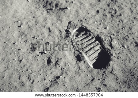 Step on the moon. Elements of this image furnished by NASA #1448557904