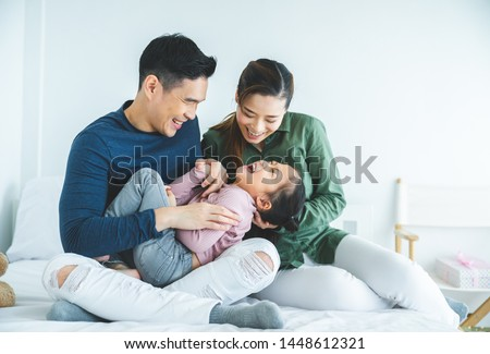 Happy family with daughters playing at home and weekend for family #1448612321