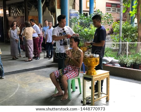 Atmosphere in the traditional ordination ceremony, group of anonymous thai people attend a ceremony,buddhist ordination,take the tonsure,become the monk,in church at temple,Bangkok,Thailand,2019. #1448770973