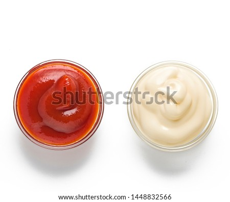 ketchup, mustard, mayonnaise in glass bowls on a white background. Traditional fast food and barbecue sauces. #1448832566