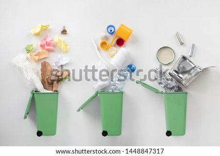 top view of trash bins and sorted garbage on grey, recycle concept #1448847317