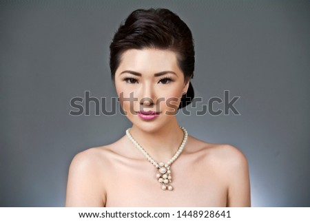 Fashion asian portrait of young beautiful woman with jewelry. Brunette girl. Perfect make-up. #1448928641