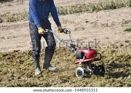 Cultivators driving in the vegetable garden #1448955311