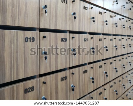wooden lockers In the office. Modern wood Interior of a locker. many key hanging on lockers. many row of wooden safety lockers. Concept personal safety in office building.  #1449051287