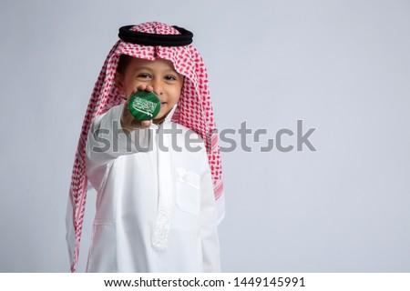 Saudi boy celebrating national day Royalty-Free Stock Photo #1449145991