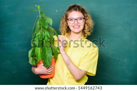 Botany and biology lesson. Botanical expert. Botany education. Greenery benefits. Botany and nerd concept. Woman school teacher chalkboard background carry plant in pot. Take good care plants. #1449162743