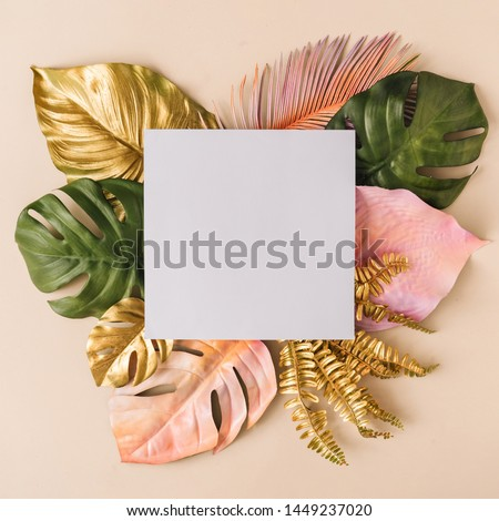 Creative layout made of colorful and golden tropical leaves and palms on beige background. Minimal summer exotic concept with copy space. Border arrangement background. #1449237020