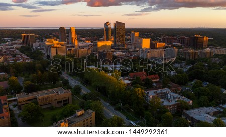 an aerial view of White Plains New York at sunset look up on the horizon for Manhattan #1449292361