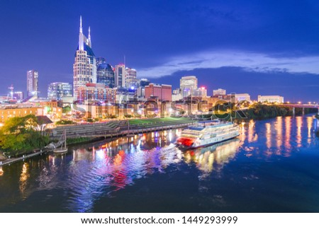 Nashville, Tennessee, USA skyline and riverboat on the Cumberland River at night. #1449293999