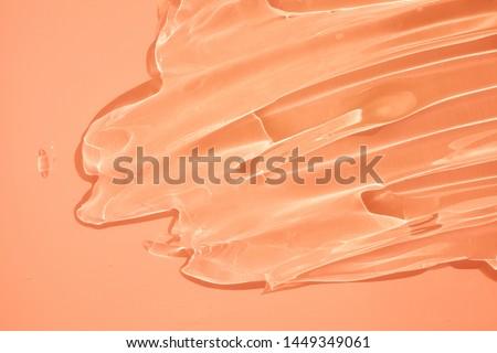 Cream gel cosmetic lubricant  background transparent smudge pink orange #1449349061