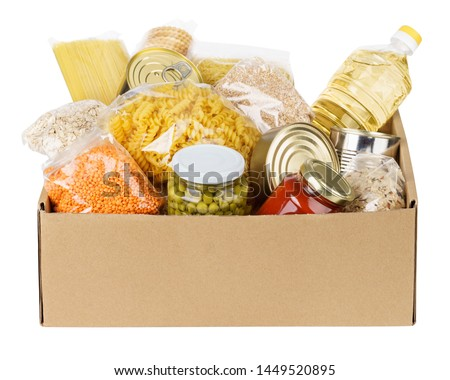 Various canned food, pasta and cereals in a cardboard box. Food donations or food delivery concept. Isolated on white. #1449520895