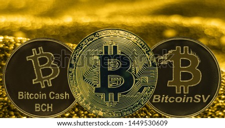 Coins cryptocurrency Bitcoin Cash SV and gold fabric background. Token BCH BSV BTC #1449530609
