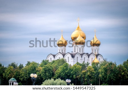 golden domes of the Russian church with crosses in Yaroslavl #1449547325