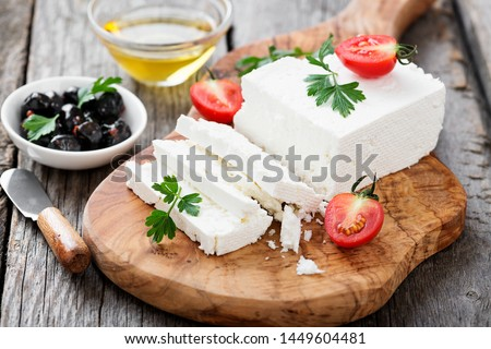 Sliced Feta cheese with herbs and olive oil. #1449604481