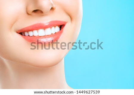 Perfect healthy teeth smile of a young woman. Teeth whitening. Dental clinic patient. Stomatology concept. #1449627539