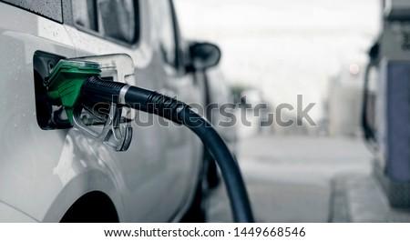 Pumping gasoline fuel in car. #1449668546