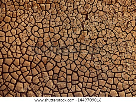 Desert. Aerial view of a beautiful cracks in the ground. texture, deep crack. Effects of heat and drought. effects of global warming. cracked desert landscape. #1449709016