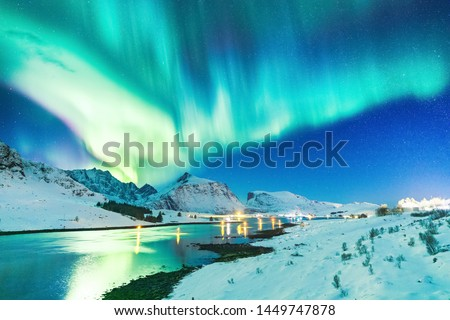 Lofoten Islands, Norway. Amazing winter landscape - Aurora Borealis natural wonder making dramatic night sky on March. Northern lights over Polar Circle. #1449747878