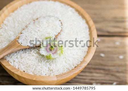 white rice (Thai Jasmine rice) in wooden bowl with wooden spoon on wood background. #1449785795