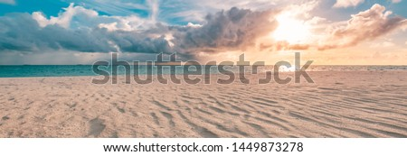 Closeup of sand on beach and blue summer sky. Panoramic beach landscape. Empty tropical beach and seascape. Orange and golden sunset sky, soft sand, calmness, tranquil relaxing sunlight, summer mood #1449873278