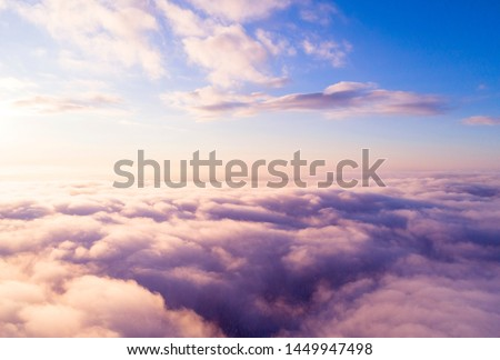 Aerial view White clouds in blue sky. Top view. View from drone. Aerial bird's eye clouds. Aerial top cloudscape. Texture of clouds. View from above. Sunrise or sunset over clouds #1449947498