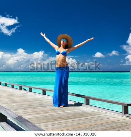 Woman on a tropical beach jetty at Maldives #145010020