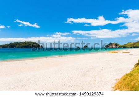 Photo of a beautiful white sand Hahei beach at Cathedral Cove Marine Reserve, Coromandel Peninsula, New Zealand.  #1450129874
