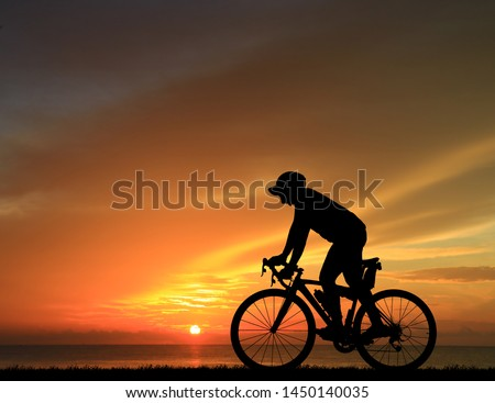 Silhouette  Cycling  on blurry sunrise  sky   background. #1450140035