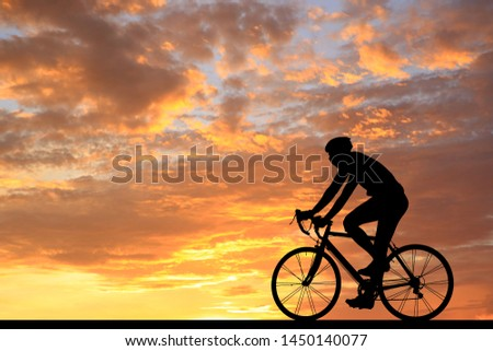 Silhouette  Cycling  on blurry sunrise  sky   background. #1450140077
