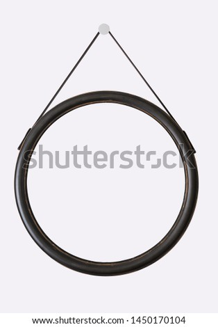 Circle wooden frame hang on circle white color pin isolated on background