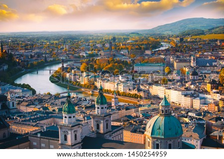 Beautiful of Aerial panoramic view in a Autumn season at a historic city of Salzburg with Salzach river in beautiful golden evening light sky and colorful of autumn at sunset, Salzburger Land, Austria #1450254959