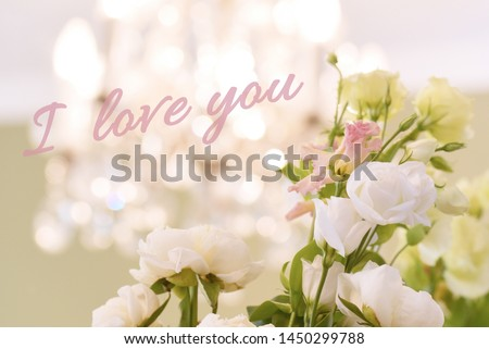 White flower bucket with chandelier background. Bokeh lights, shining chandelier , white roses.   I love you.