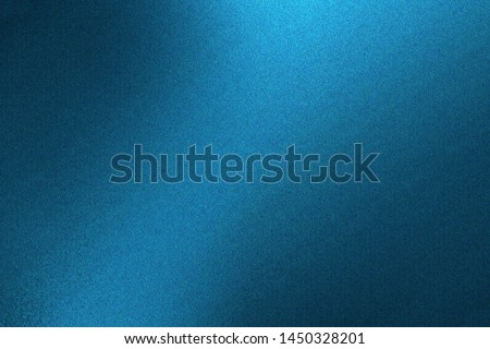 Light shining on blue metallic wall in dark room, abstract texture background #1450328201