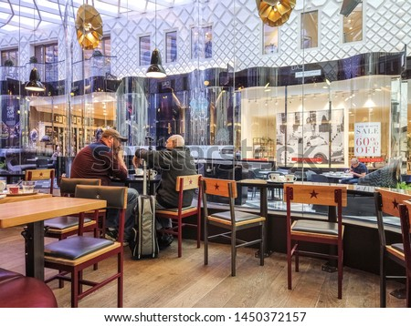 LEEDS, UK - JULY 13, 2019: Customers in the interior of Pret a Manger, a British international sandwich shop chain #1450372157
