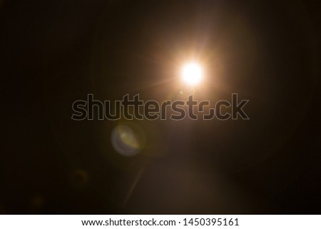 Abstract Natural Sun flare on the black #1450395161