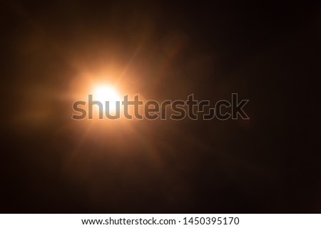 Abstract Natural Sun flare on the black #1450395170