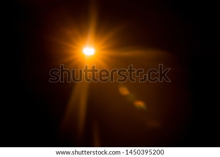Abstract Natural Sun flare on the black #1450395200