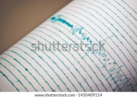 Seismograph Record of an Earthquake Royalty-Free Stock Photo #1450409114