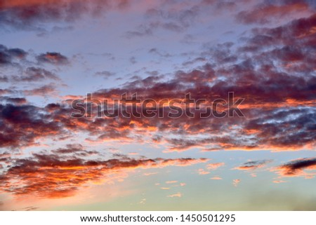 Red clouds at sunset, fire on black background #1450501295