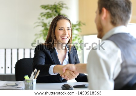 Happy businesspeople handshaking after deal or interview at office Royalty-Free Stock Photo #1450518563